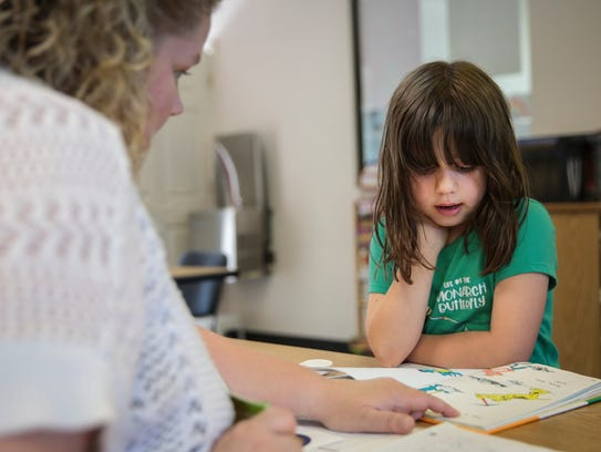 Natalie Zorn, 6, of Dearborn Heights, reads the book