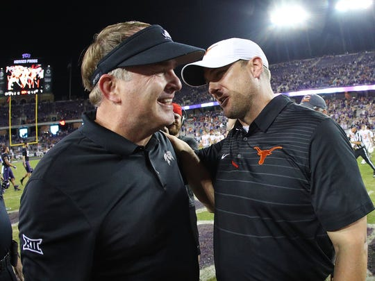 FORT WORTH, TX - NOVEMBER 04:  Head coach Gary Patterson of the TCU Horned Frogs is congratulated by head coach Tom Herman of the Texas Longhorns  after the 24-7 victory at Amon G. Carter Stadium on November 4, 2017 in Fort Worth, Texas.  (Photo by Richard W.  Rodriguez/Getty Images)