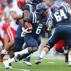 Ole Miss running back Jaylen Walton (6) rushes for a touchdown in the Rebels' win Saturday vs. Louisiana-Lafayette.