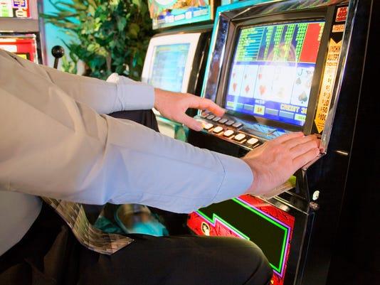 Man playing video poker