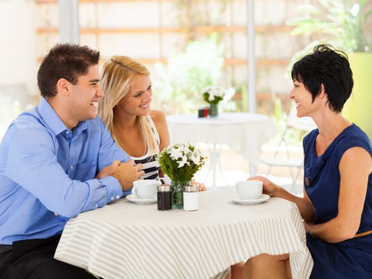 young woman with boyfriend meeting future mother in law