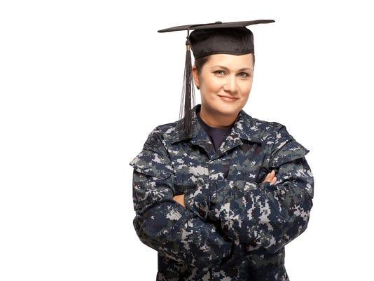 Female navy sailor with graduation cap