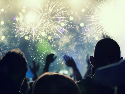 New Year concept - cheering crowd and fireworks