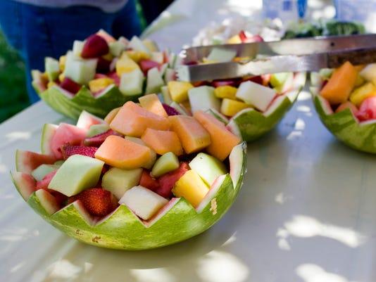 Fresh Cut Fruit Salad in Watermelon Bowl Sitting on a Table