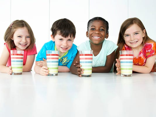 Four Children with Milk Shakes