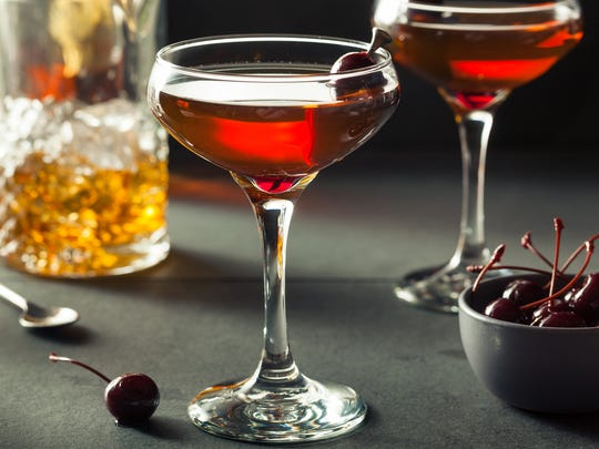 1864 Tavern's take on a manhattan is made with whiskey, Cardamaro and Swedish herb bitters, garnished with a slap of fresh basil.