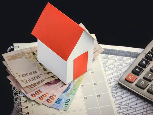 Single family house on pile of money