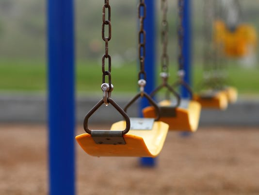 Playground swing set (selective focus)