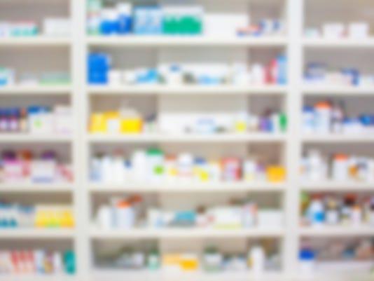 blur shelves of drugs in the pharmacy