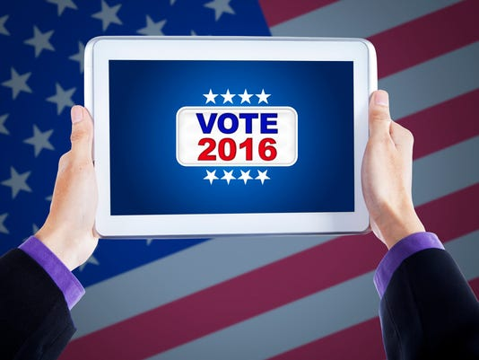 Hands holding tablet with vote button