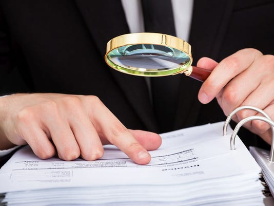 Businessman Analyzing Document