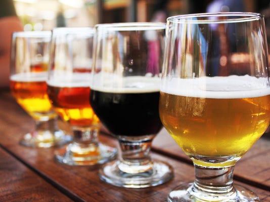 Beer Flight of four beers in glasses