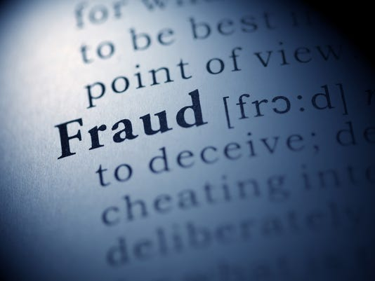 Picture of a dictionary page explaining the word fraud