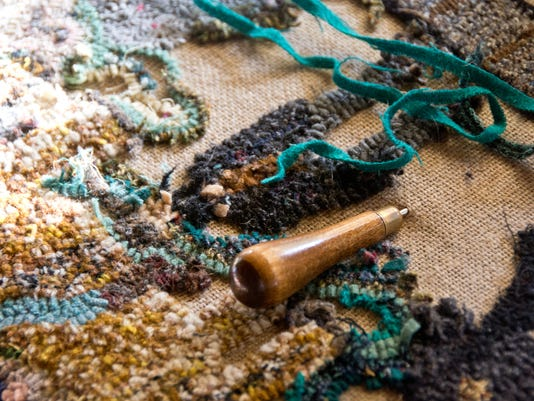 Rug hooking project with turquoise fabric