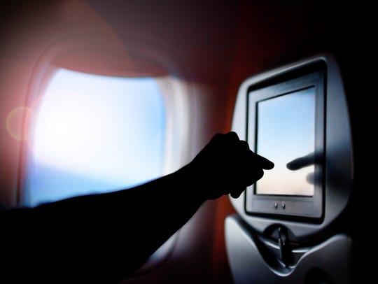 Seat passenger on the plane screen monitor. Window