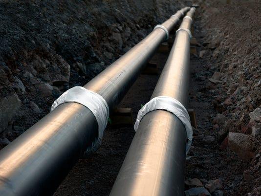 A silver, steel pipeline underground