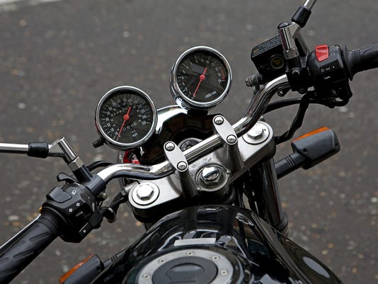 Speedometer and pressure gauge in front of motorbike handlebars