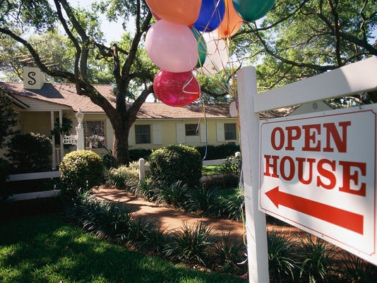 Open House sign in front of house, balloons attached