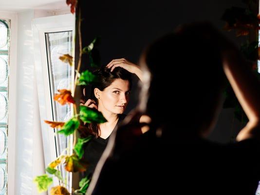 Beautiful woman in the mirror