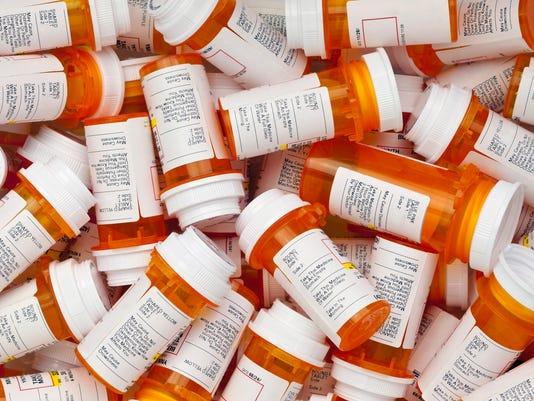 Dozens of Prescription Pill Bottles