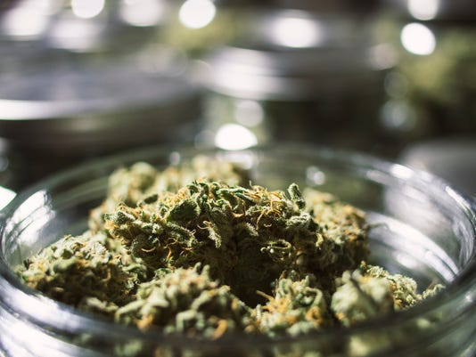 Close Up Marijuana Buds in Glass Jar with Blurry Background.jpg