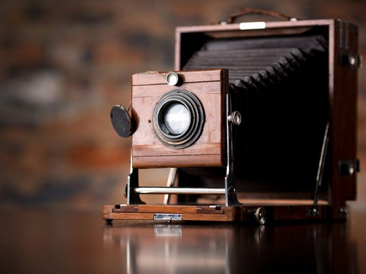 Antique Old photo Camera on wooden table