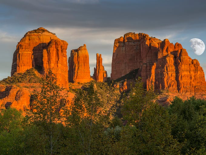 Cathedral Rocks at Sunset with rising moon in Sedona.