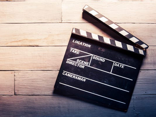 movie slate on a wooden background