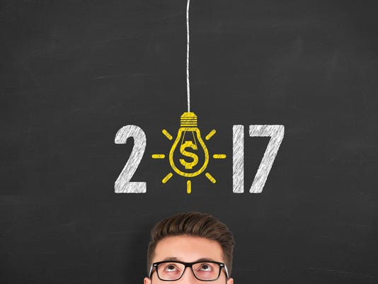 New Year 2017 Finance Concept on Chalkboard Background