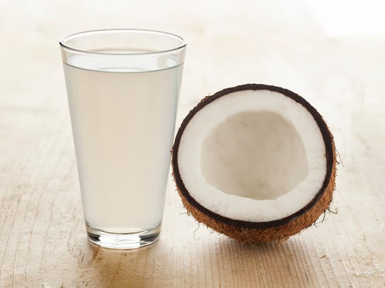 Coconut with a glass of fresh coconut water.
