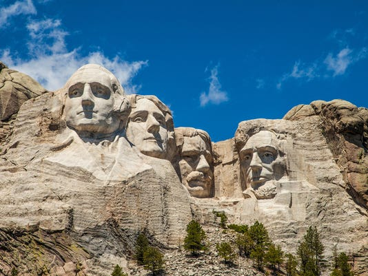 Mount Rushmore underneath a blue sky