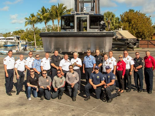 Greater Naples Fire Chief Kingman Schuldt and  administrators and first responders from Marco Island, City of Naples, and Ochopee Fire in front of the new Fire/Rescue Boat 90 that was launched from Hamilton Harbor on Thursday.