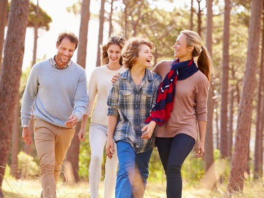 Family with teenage kids walking in the countryside