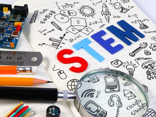 STEM concept with drawing background. Magnifying glass over education background.