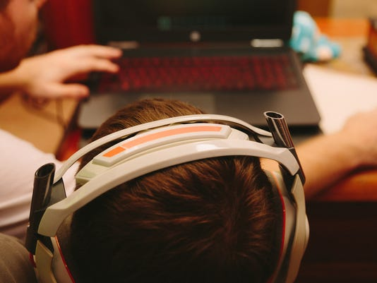 Young boy playing on computer