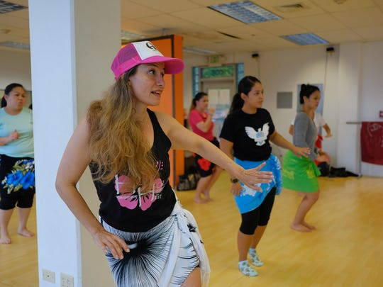 Pinki Lujan, instructor, teaches her students during the Hot Hula Class held at Synergy II in Hagåtña on March 31, 2017.