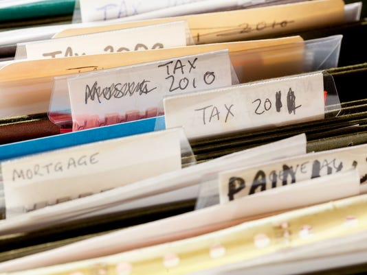 Home handmade file folders for tax papers