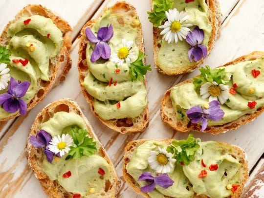 Try canapes with avocado paste and edible flowers.