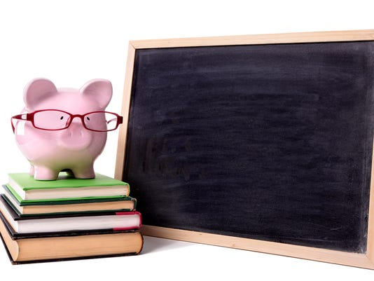 Piggy bank wearing glasses with small blank blackboard, isolated