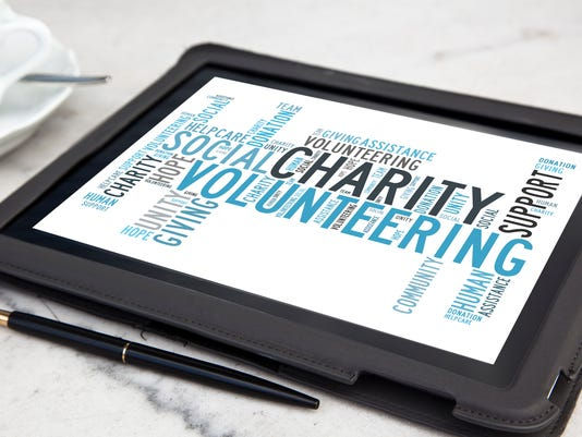 tablet with charity word cloud