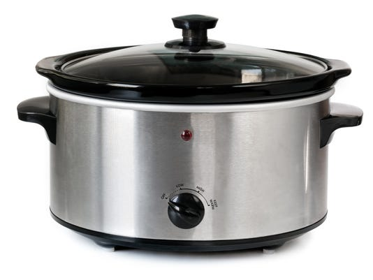 Isolated picture of a silver crock pot