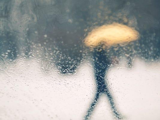 Blurred person with umbrella walking background