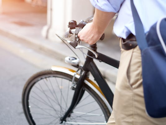 Close-up of man riding his bike in the street
