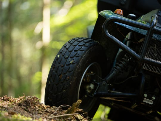 ATV parked in a forest.