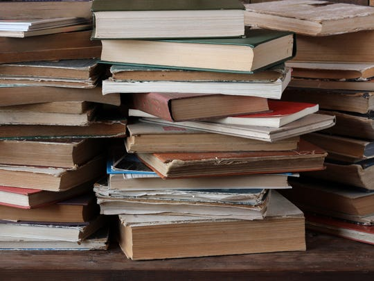 the piles of books on the table.