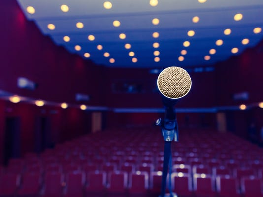 microphone on a background of dark hall with seating for