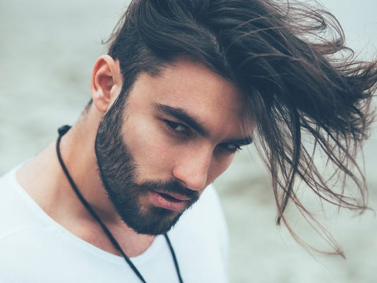 Portrait of a man with beard and modern hairstyle