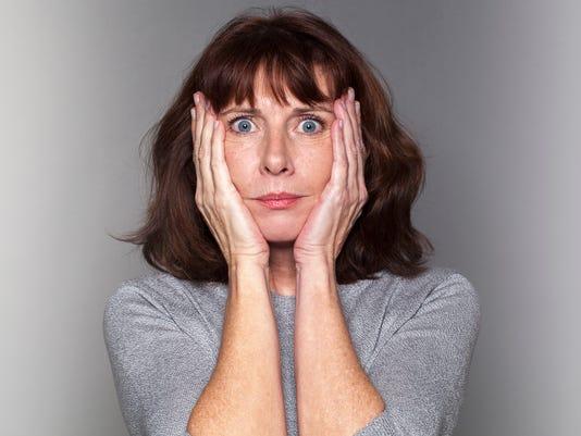 anxious senior woman under shock