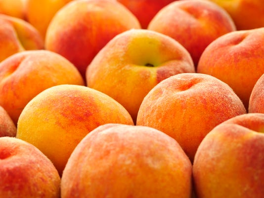 Several fresh peaches background