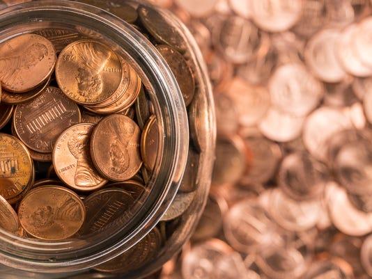 GETTYBirds eye view of penny jar overflowing